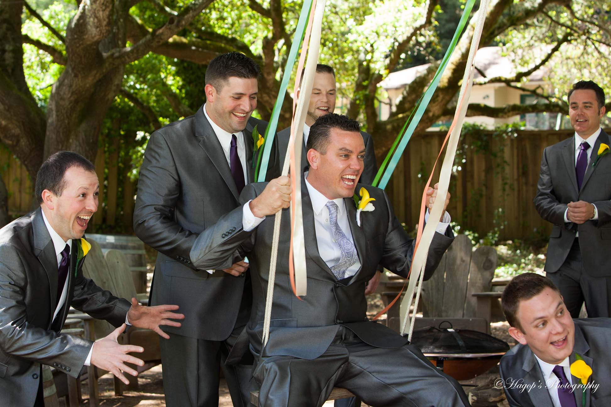 groom with groomsmen on the swing at mountain terrace