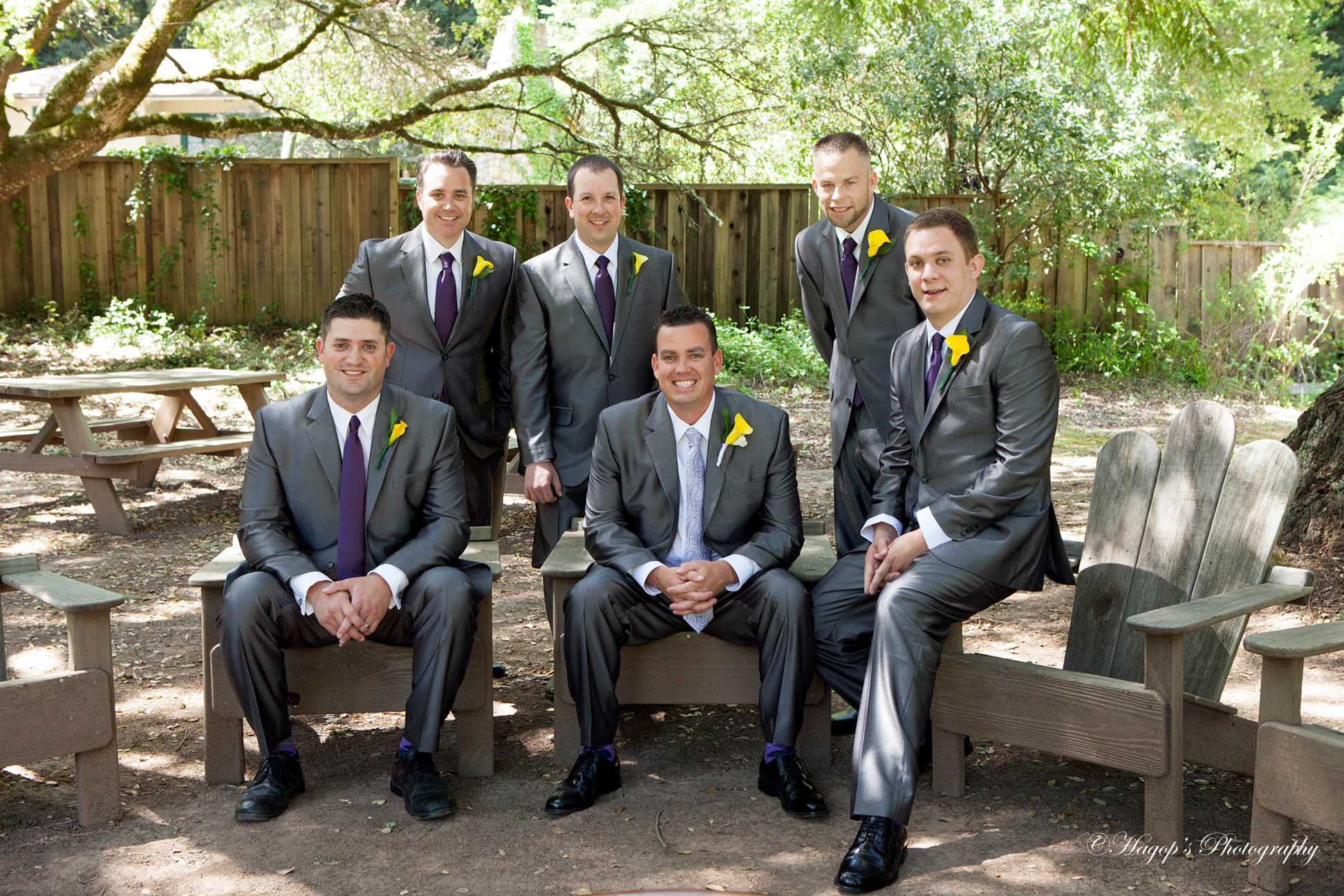 groom with his groomsmen posing for the camera