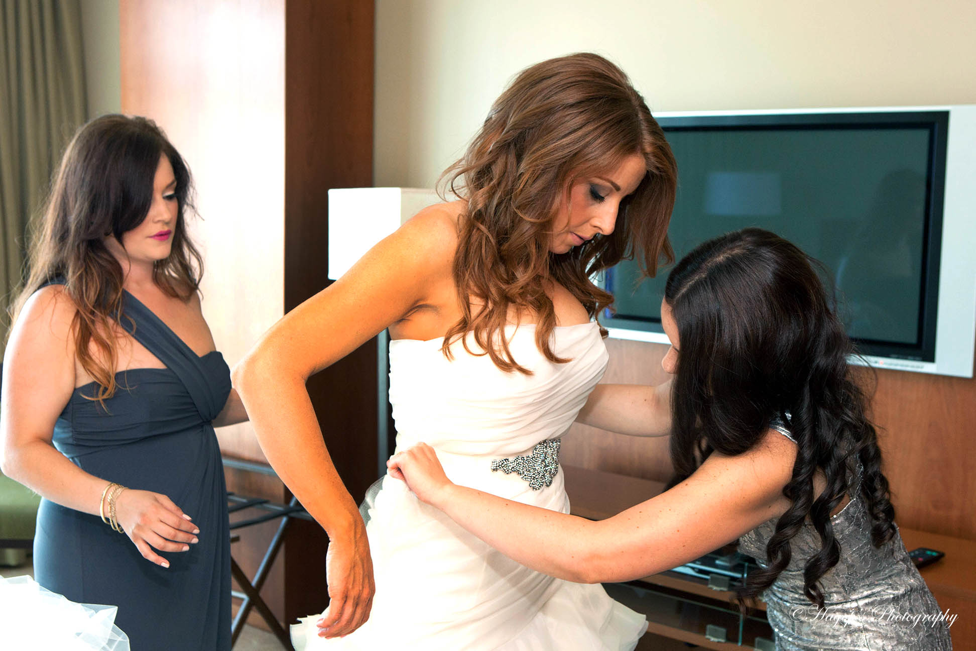 bridesmaids helping the bride getting ready