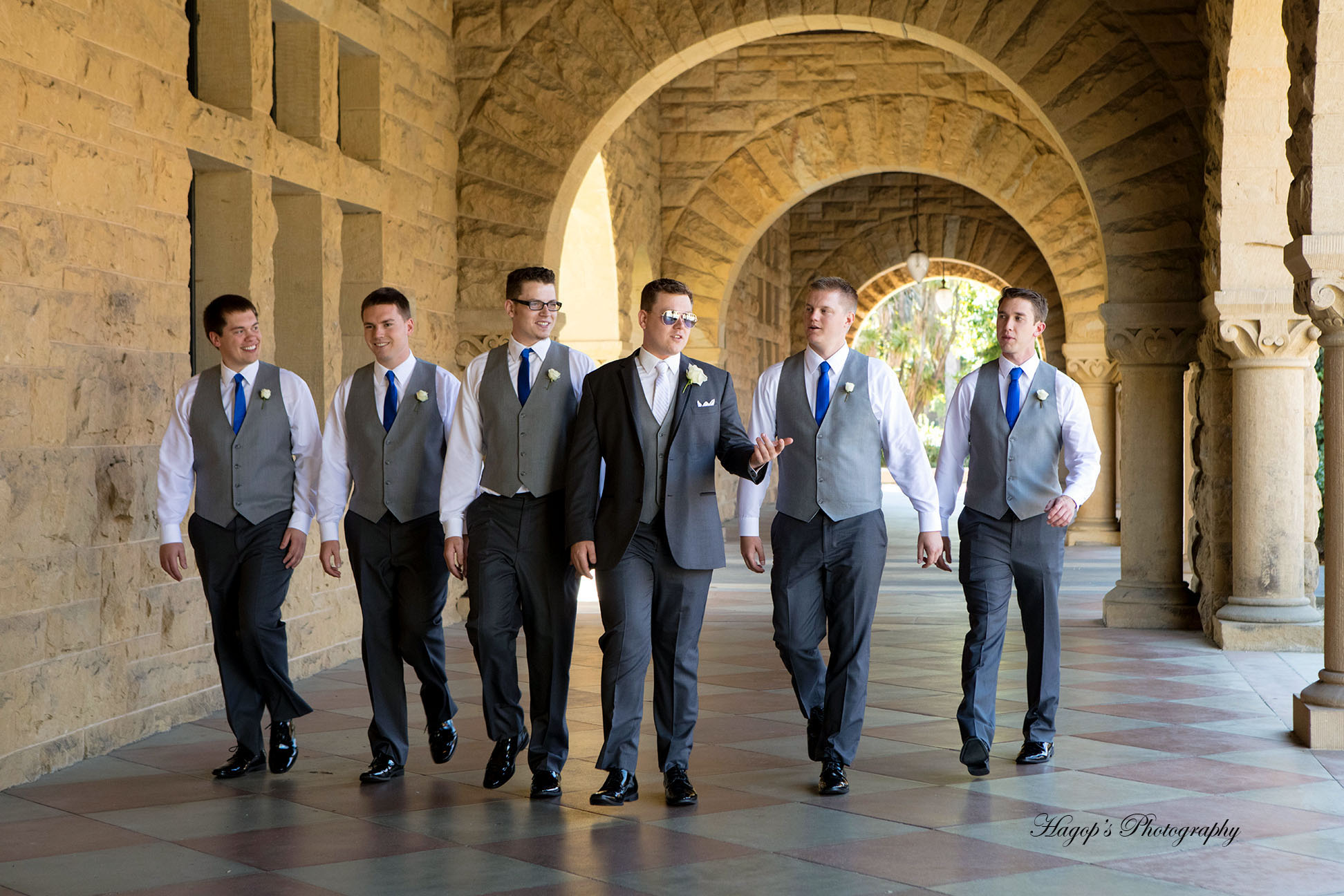 groom walking with his groomsmen at stanford