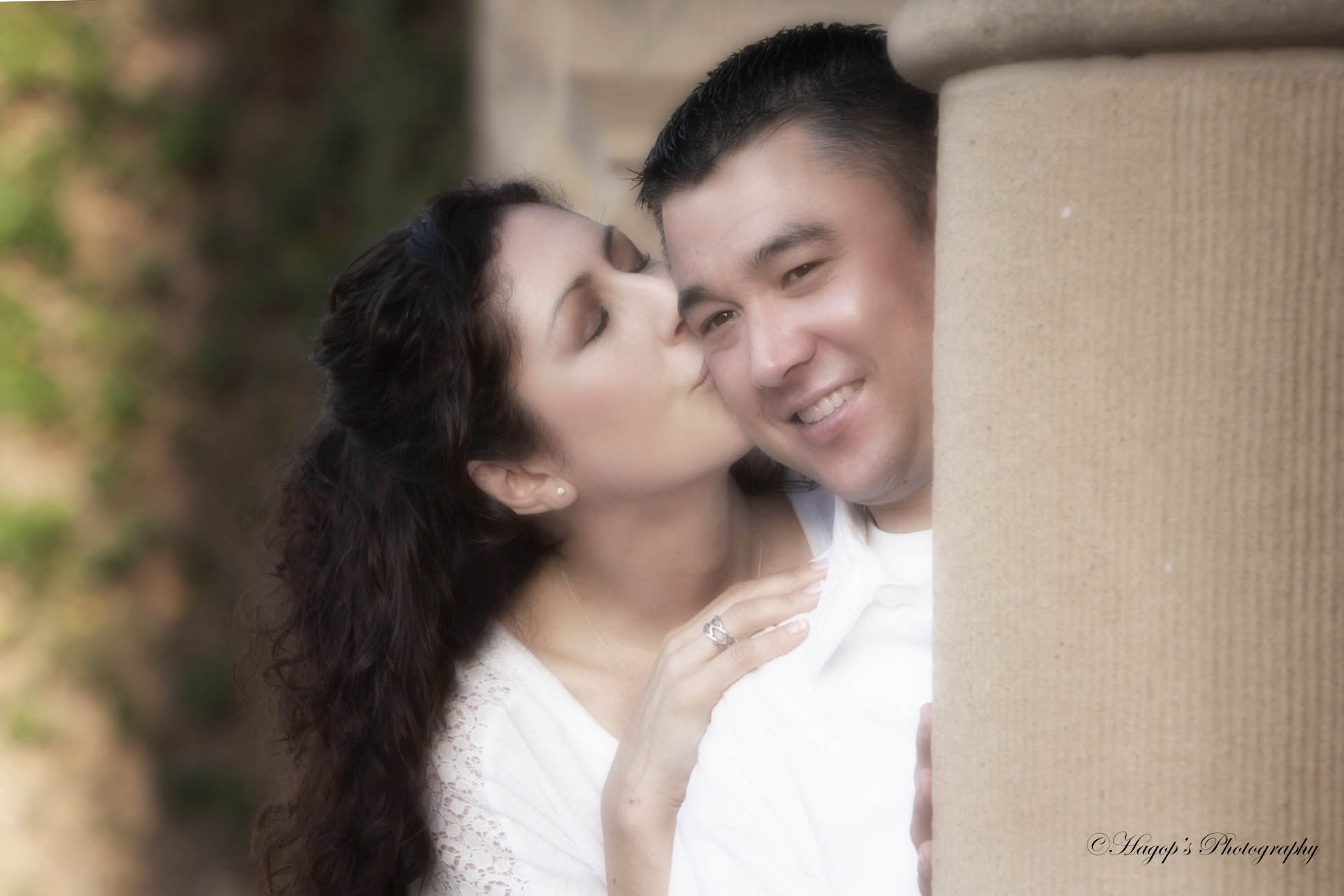 she gives her a kiss on his cheek at stanford university during their engagement session