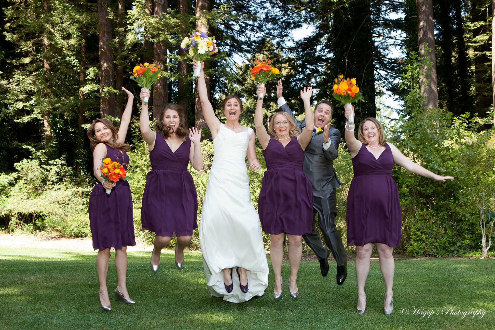 bride with her bridal party jumping photo