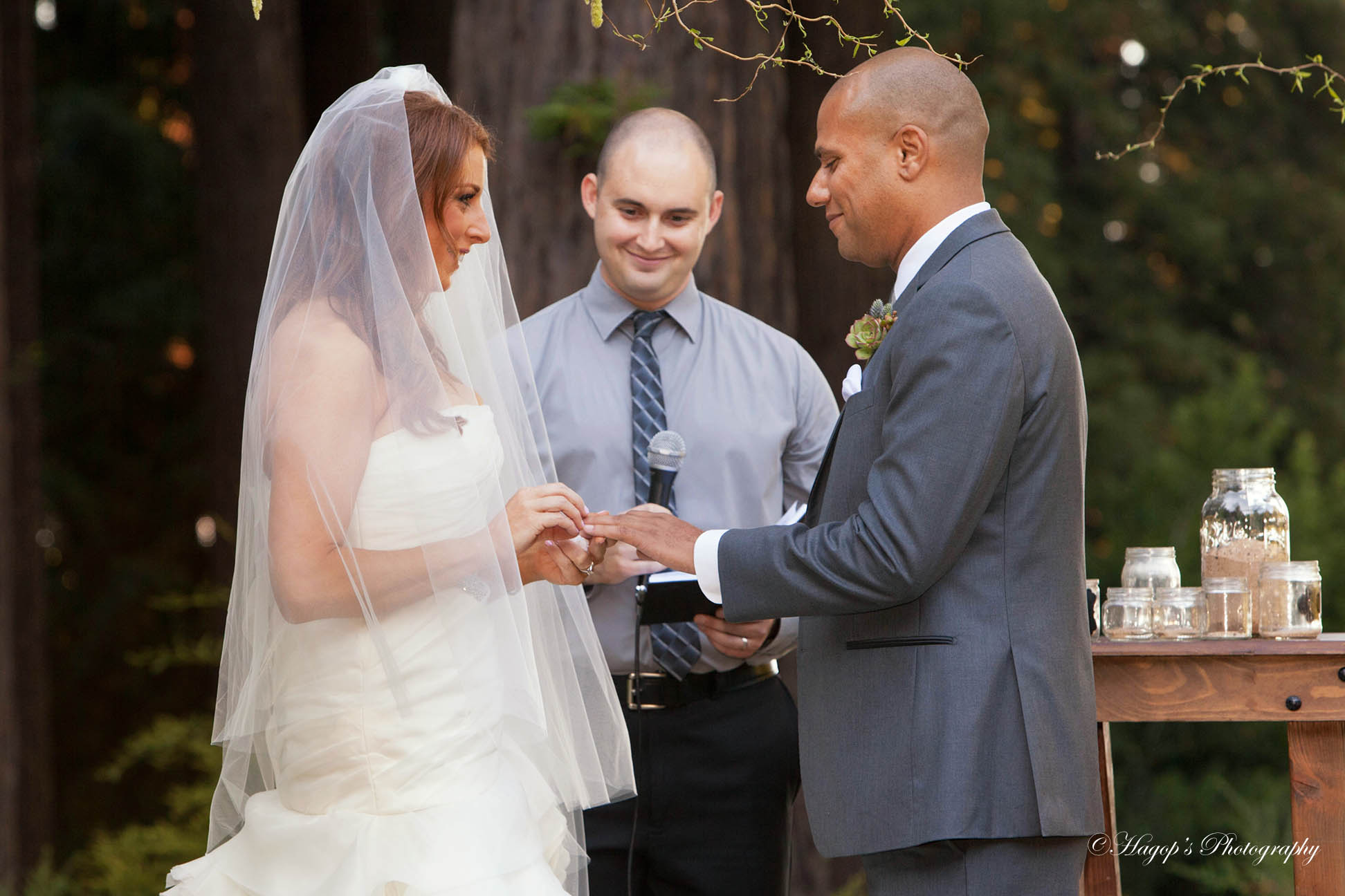 bride puts the ring on the groom