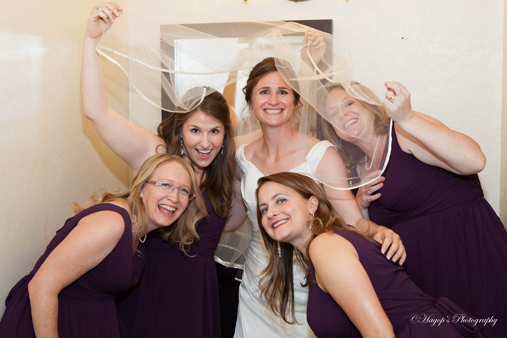 bride with her bridesmaids posing for a photo