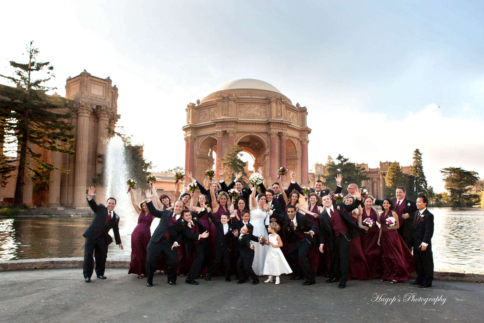 large bridal party fun photo at the legion of honor in san francisco