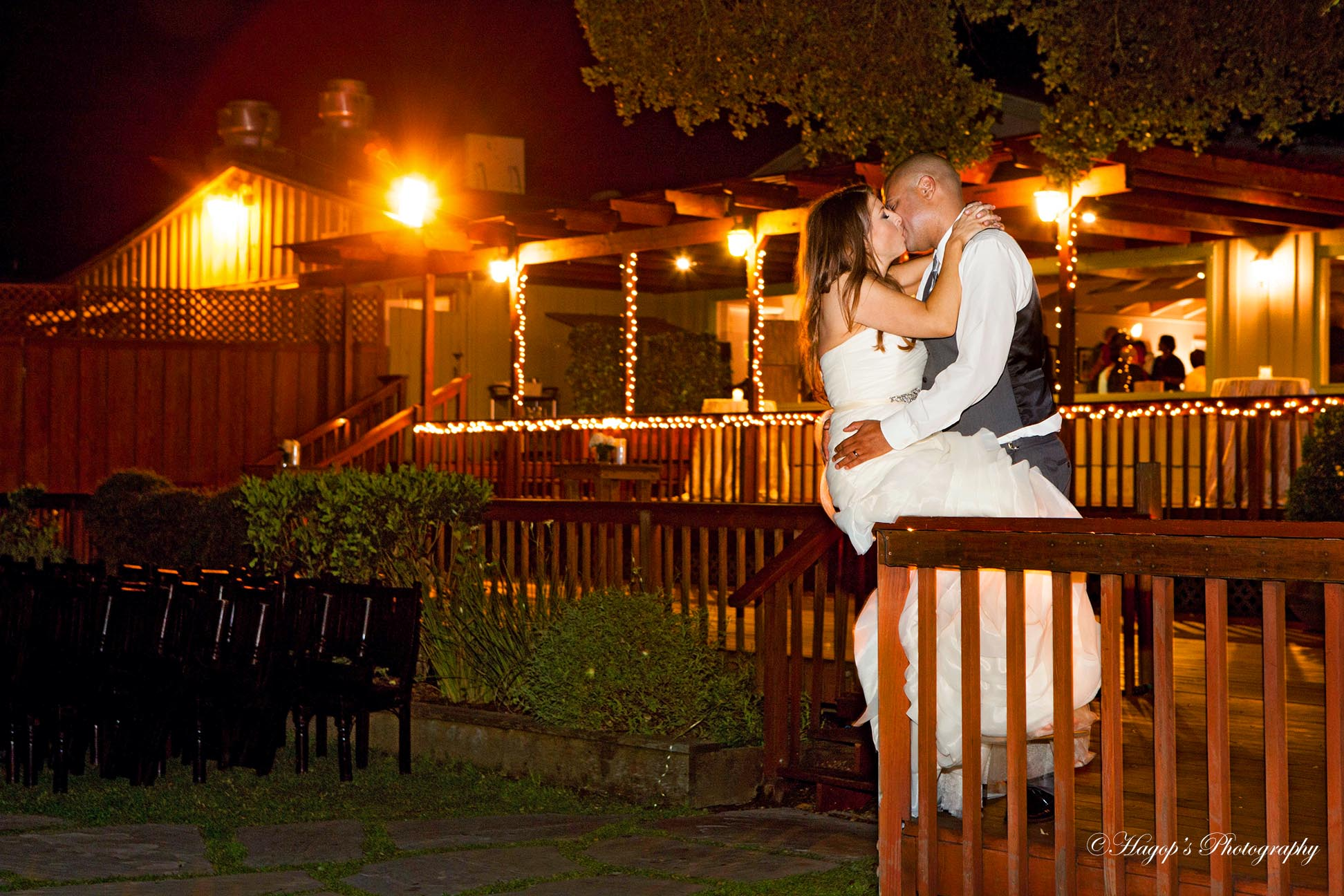 bride and groom kissing at the mountain terrace with available ambient light
