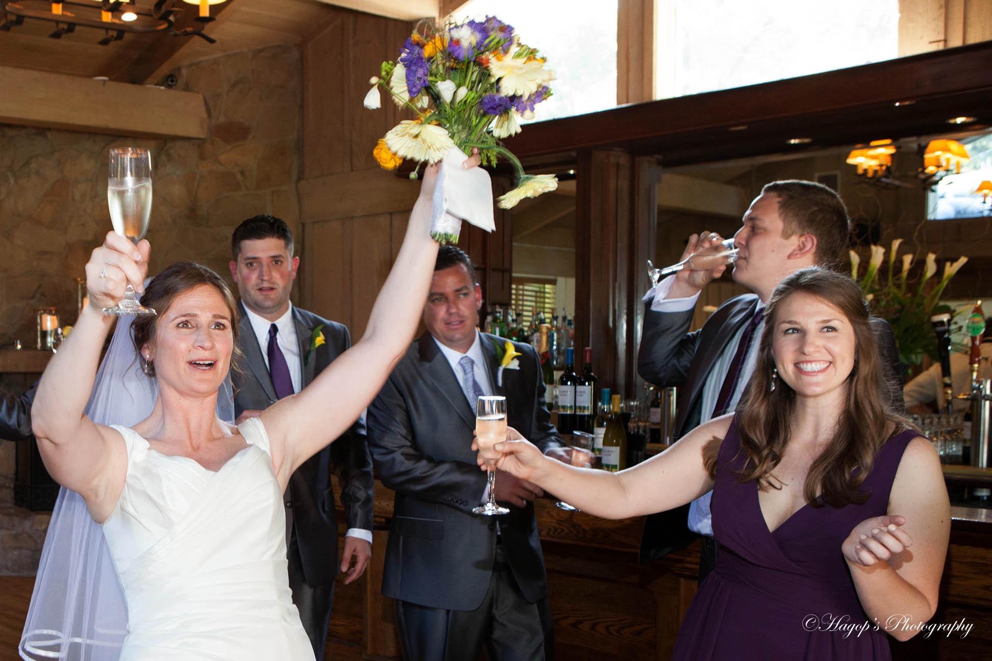 fun photo of the bride at the bar