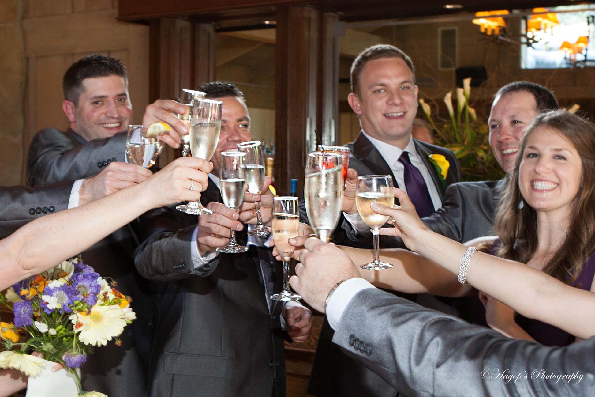 groomsmen and a bridesmaid toasting