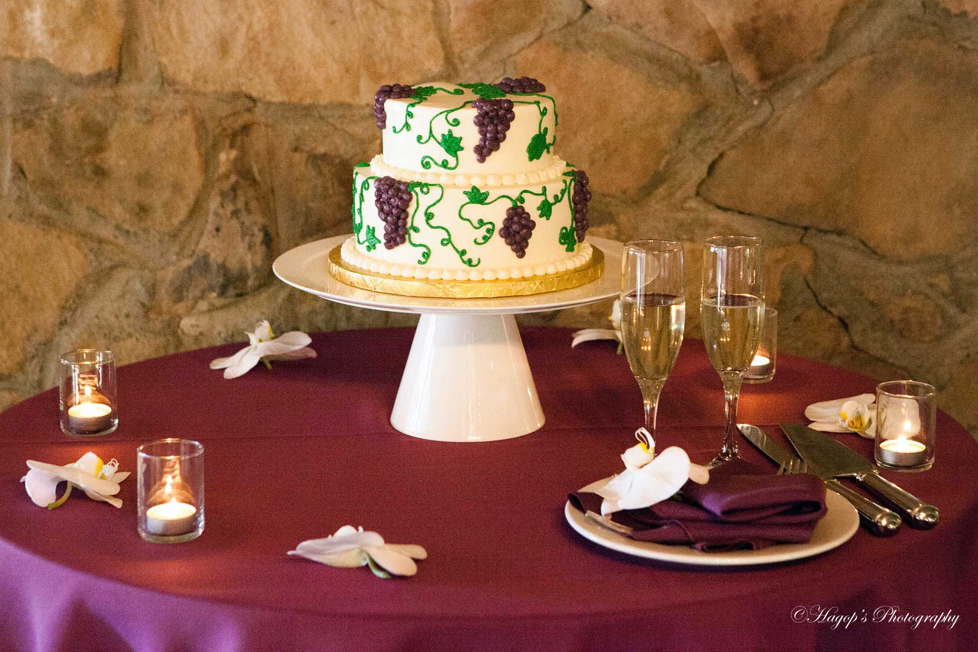 the wedding cake and champagne glasses