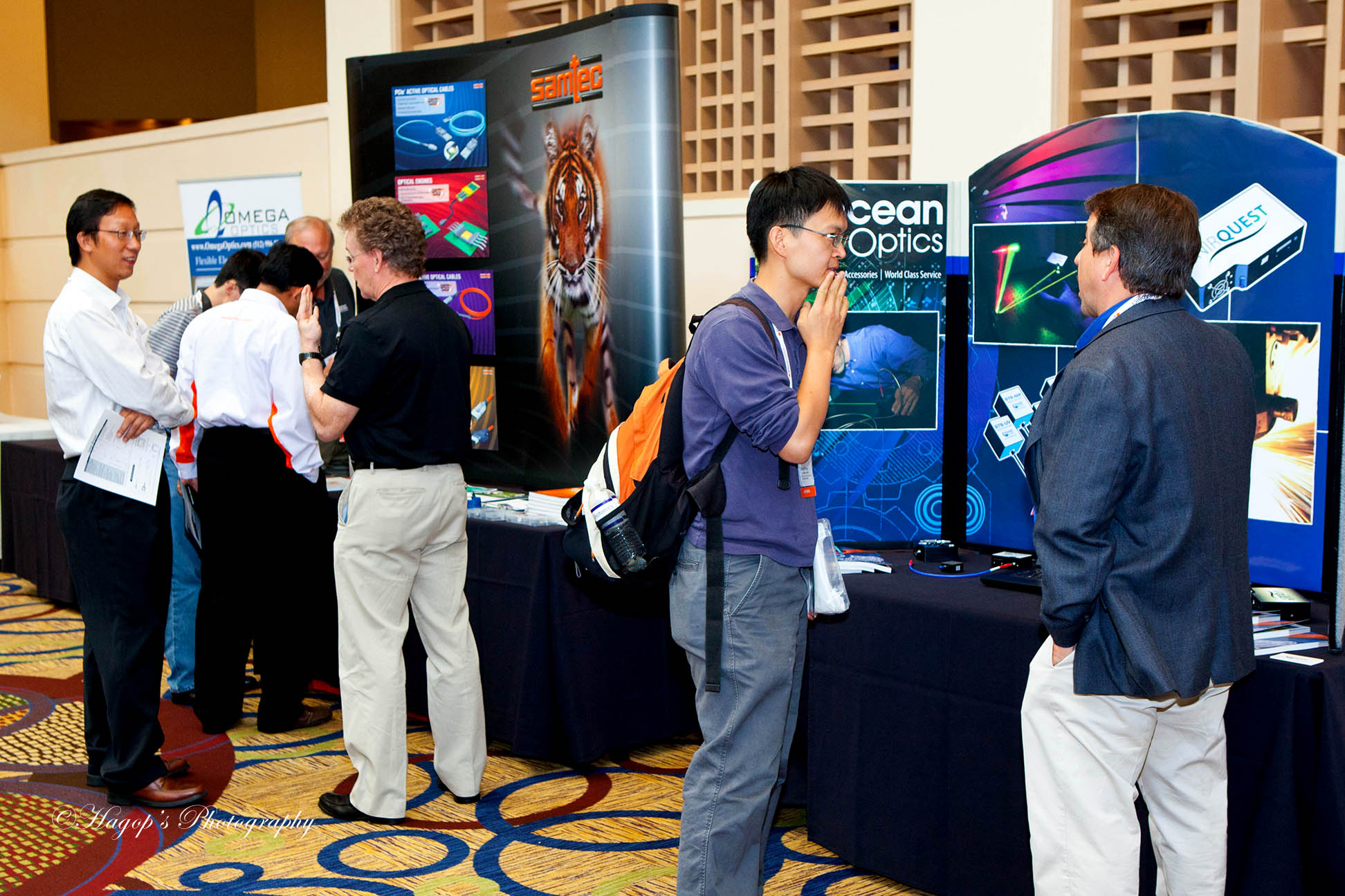 attendees visiting the vendors tables and displays