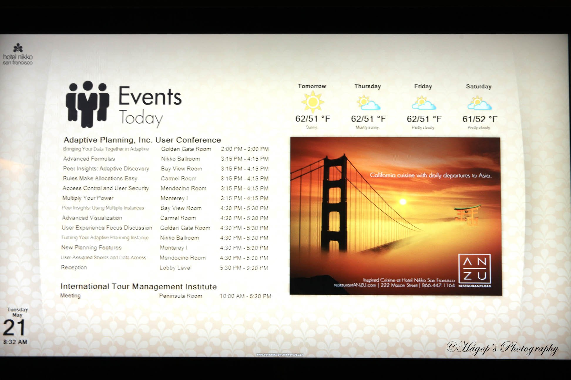monitor displaying the events of the conference