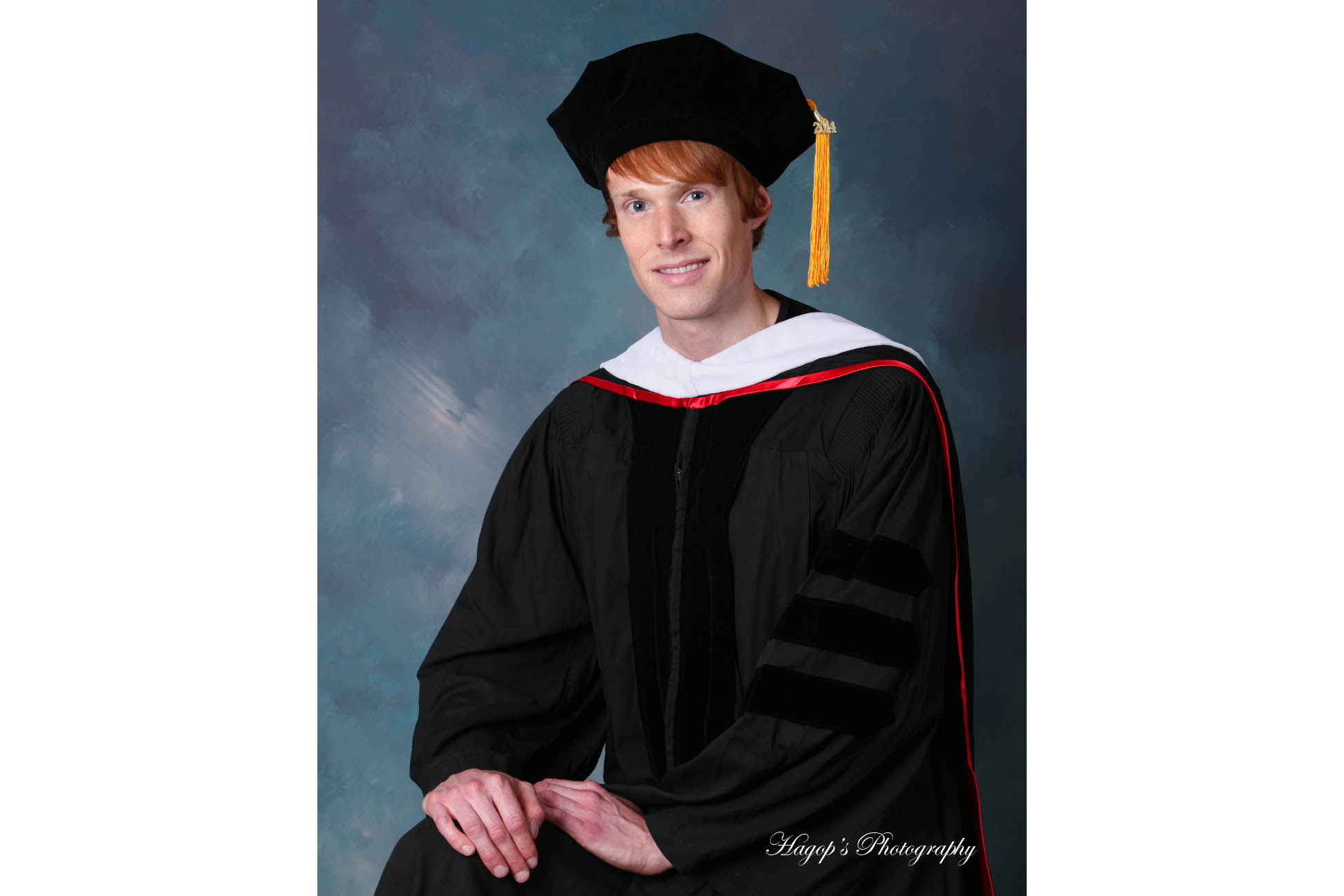 stanford male graduate portrait with cap and gown