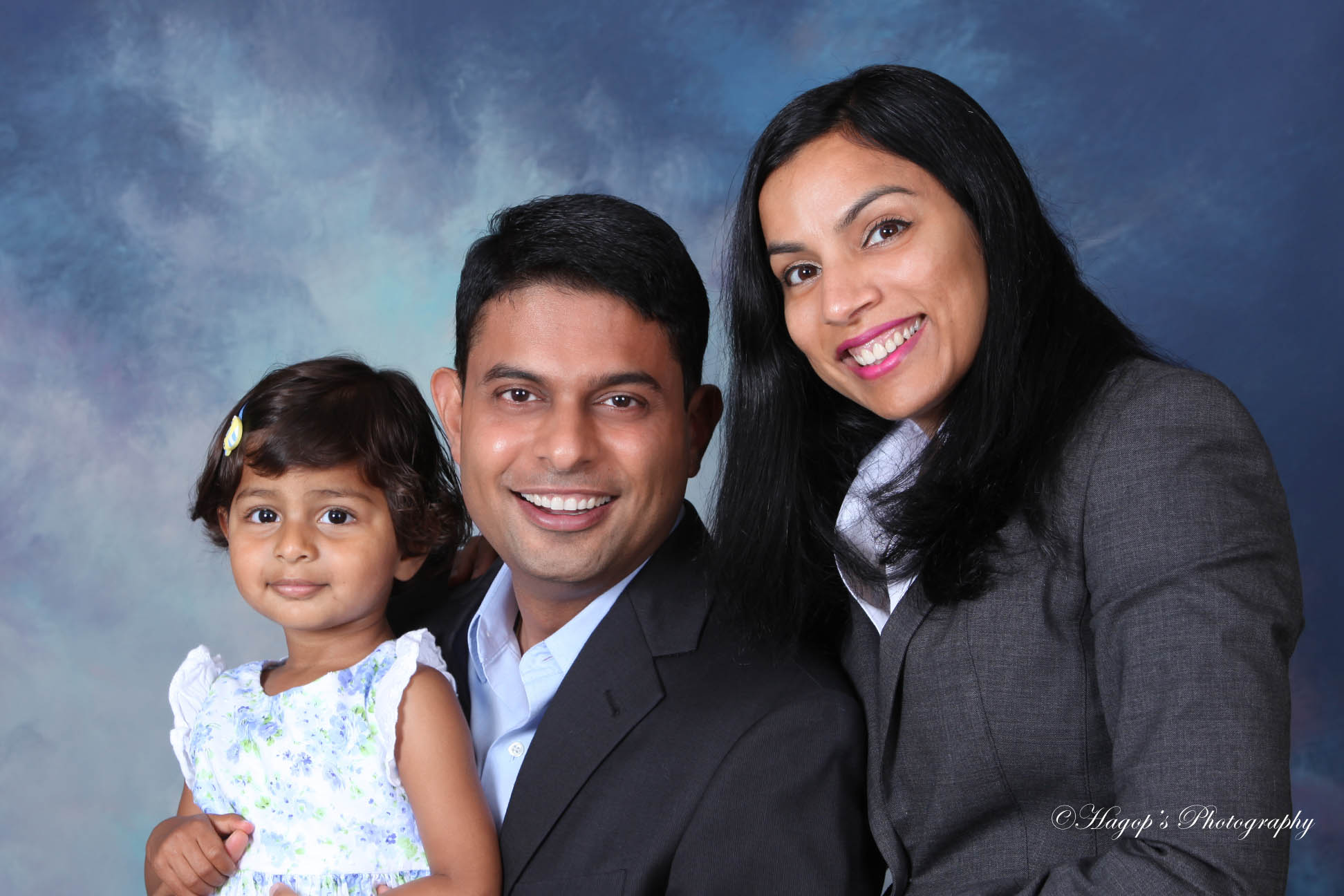 family portrait in front of a blue background