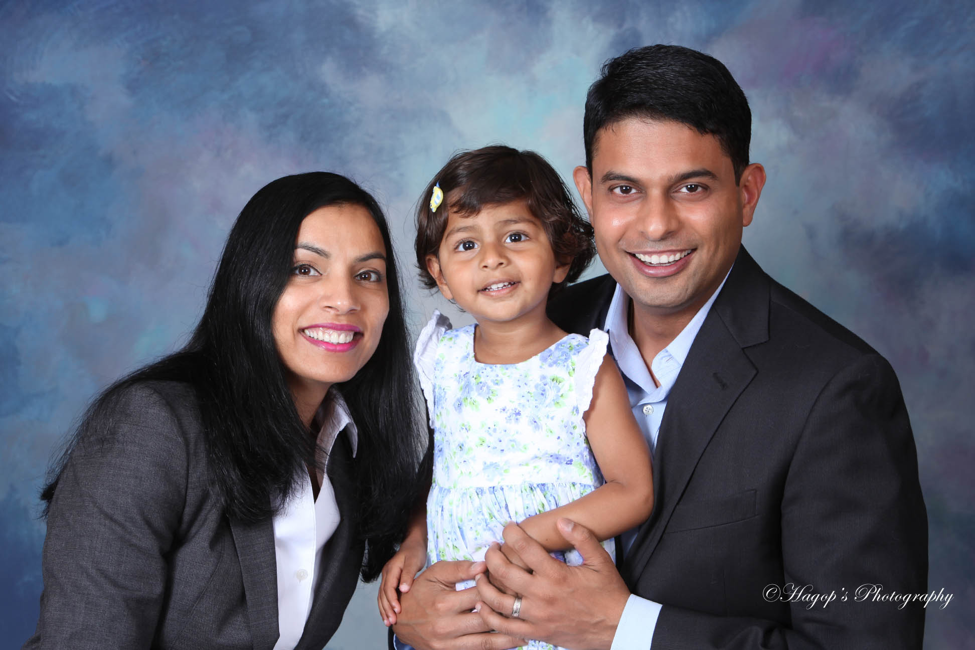 a couple with their daughter studio photo