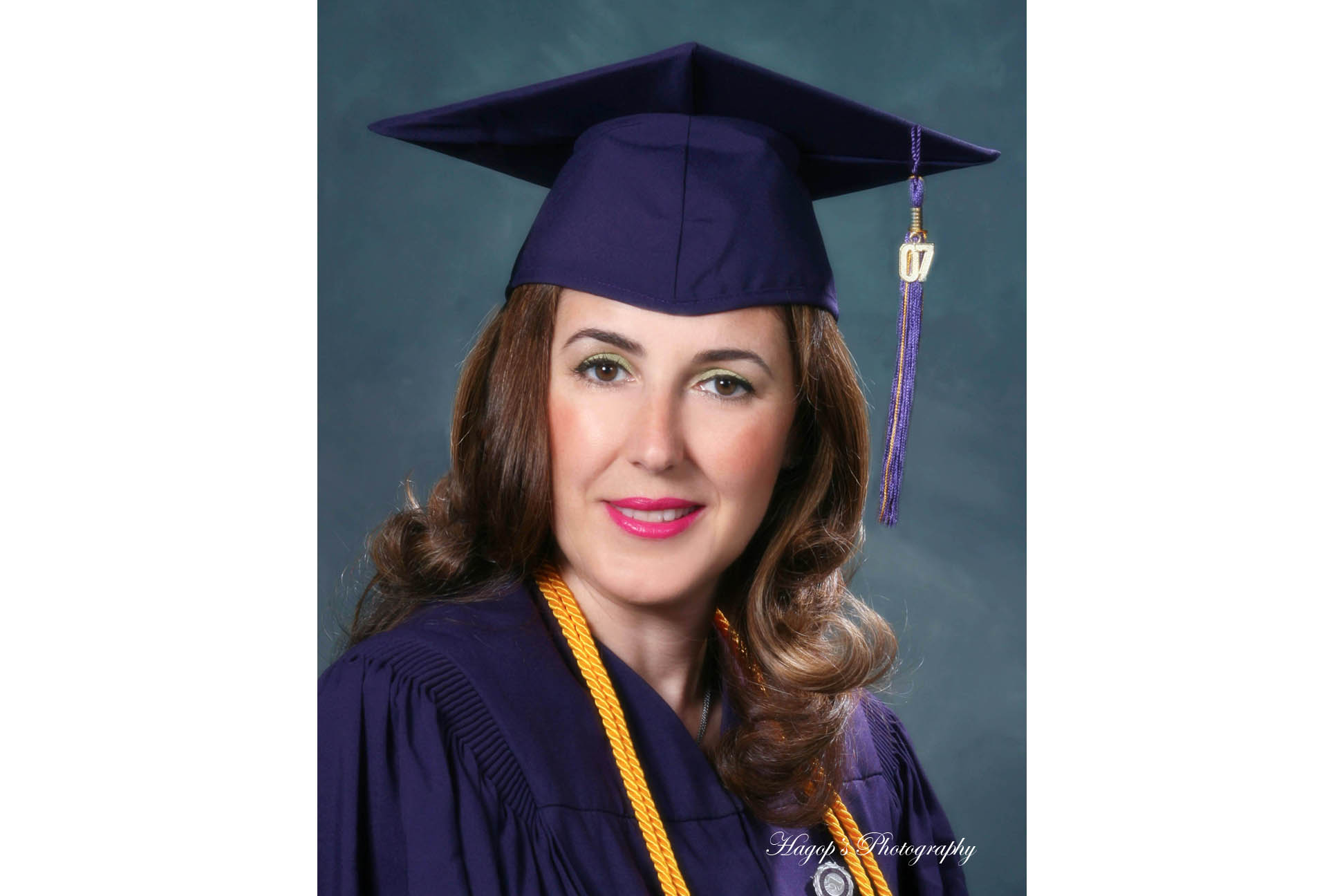 female cap and gown graduation headshot