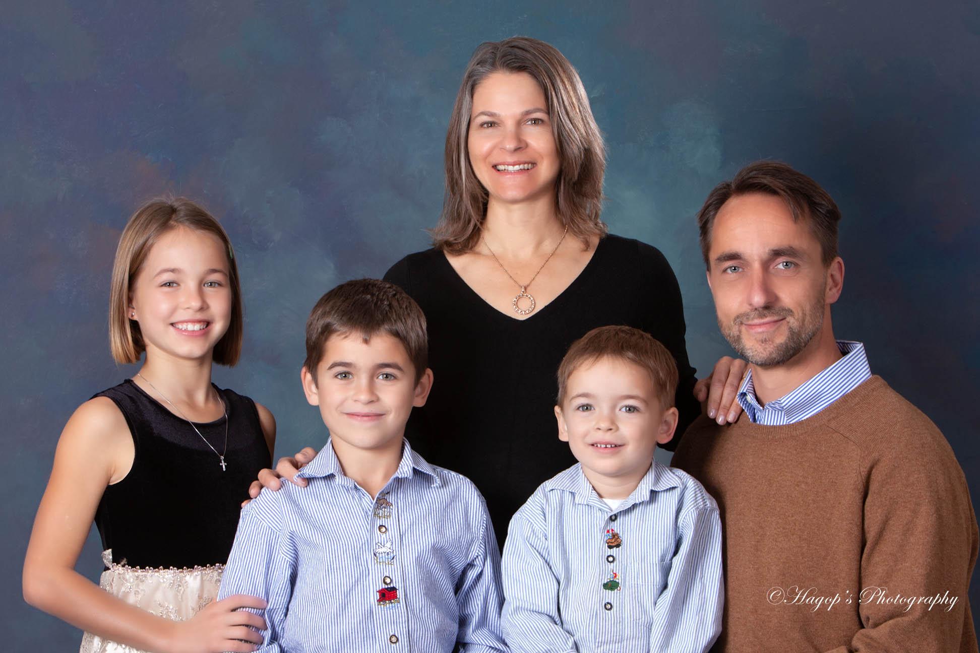 studio portrait of the parents with 3 children