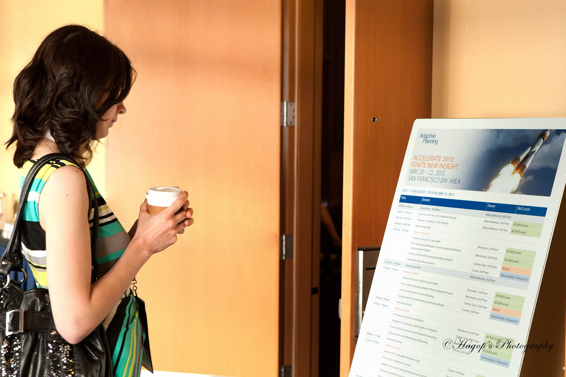 a woman looking at the conference program