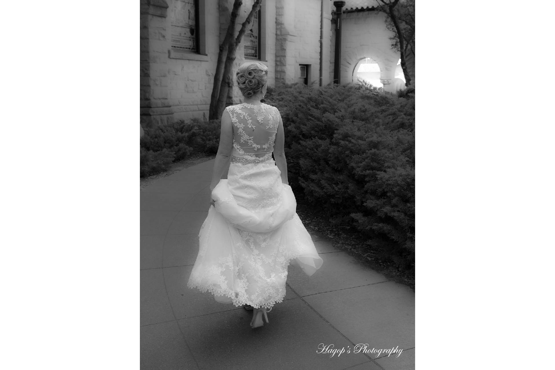bride full length photo taken from her back to show her dress