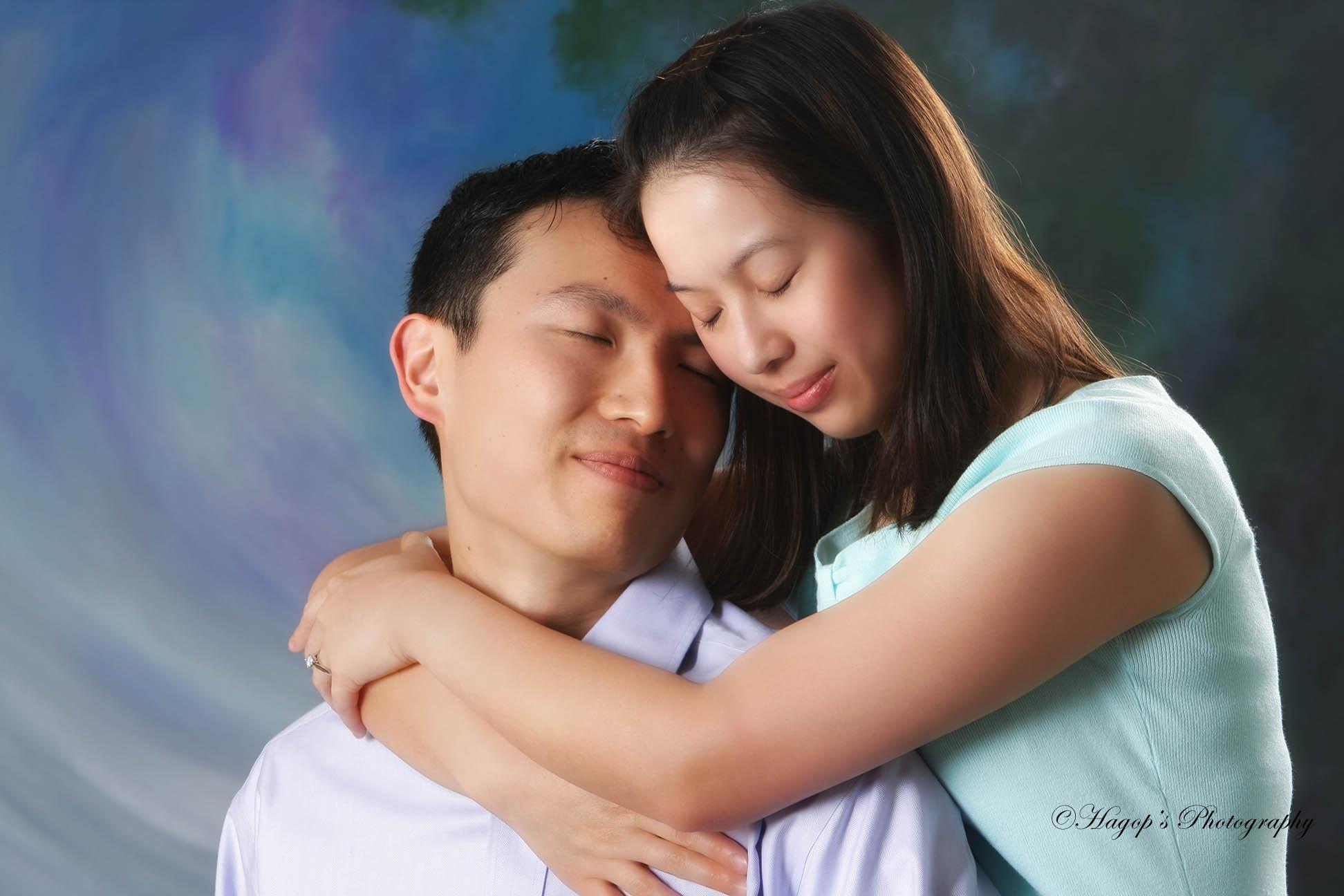 engaged couple romantic studio portrait