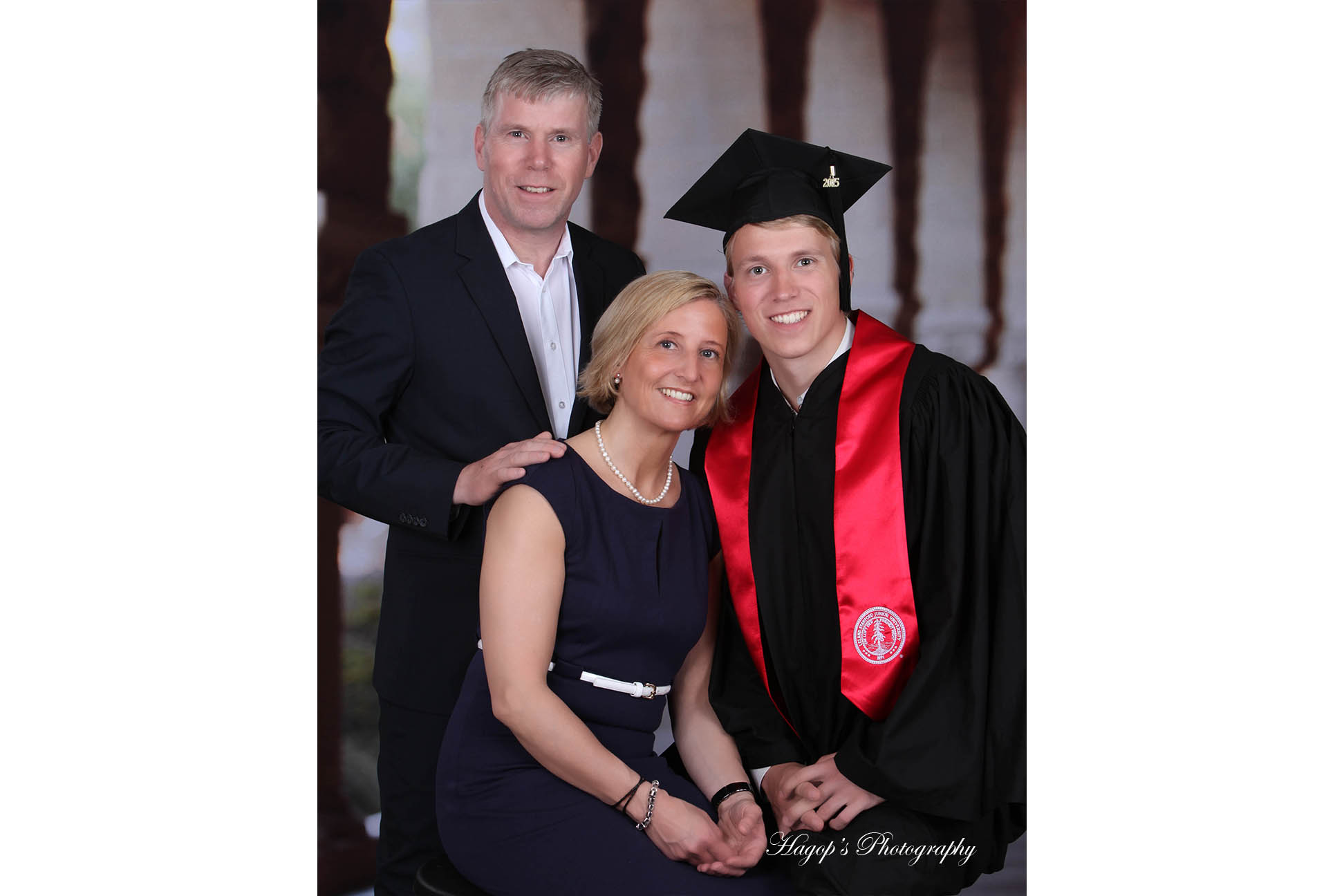 a stanford graduate posing with his parents