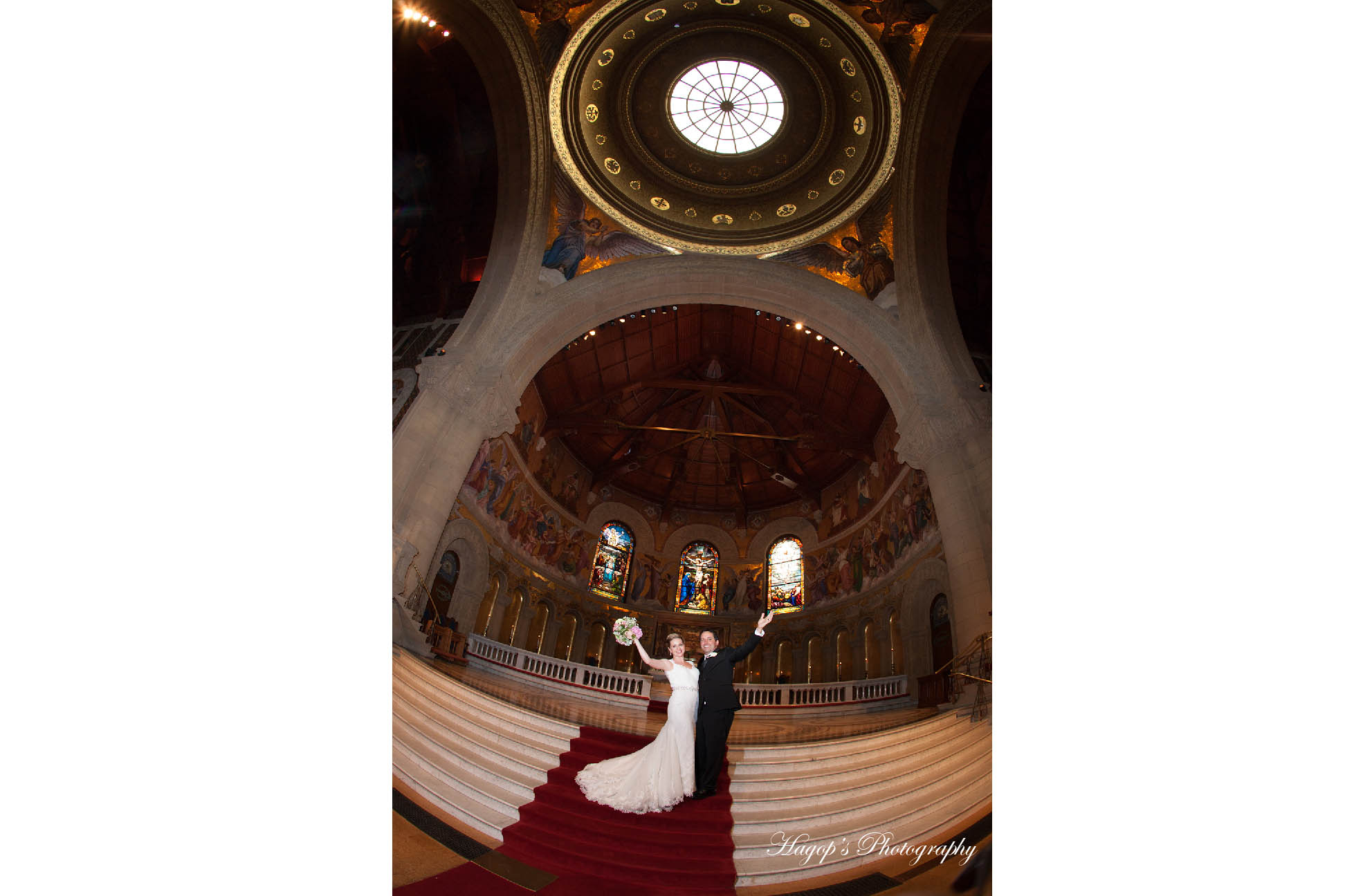 super wide angle photo of the bride and groom at stanford chapel