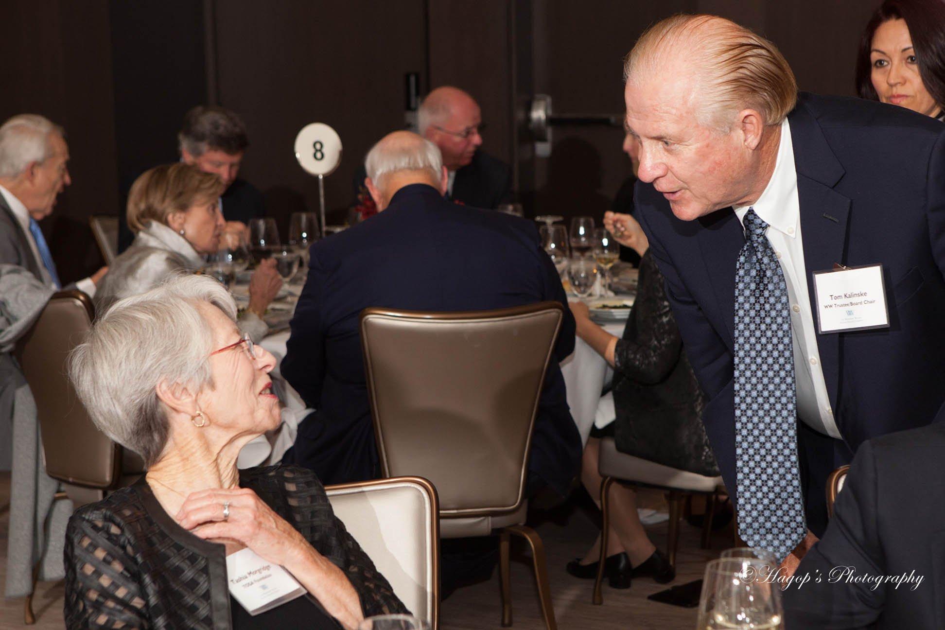 man talking to a woman