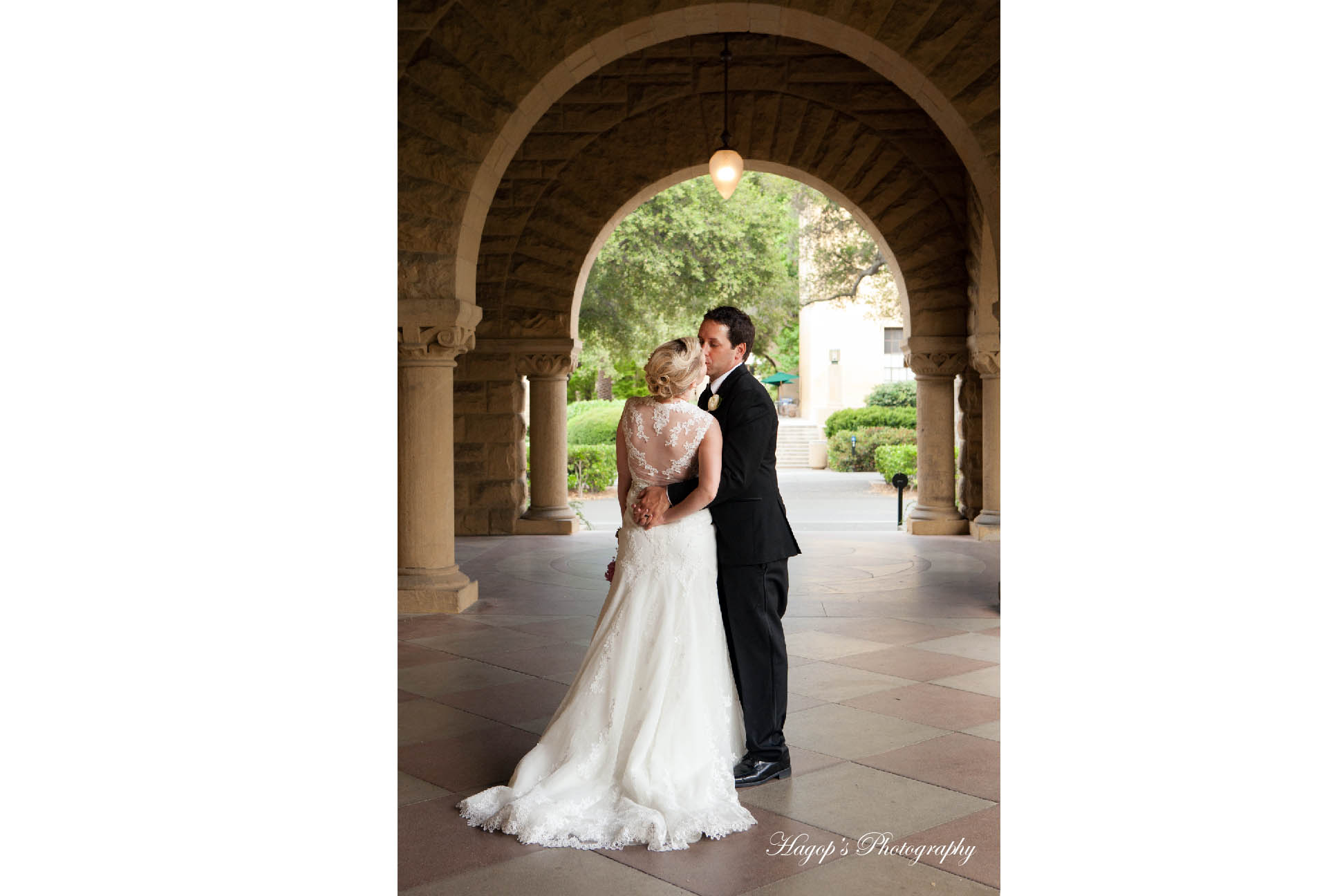 bride and groom kissing at stanford