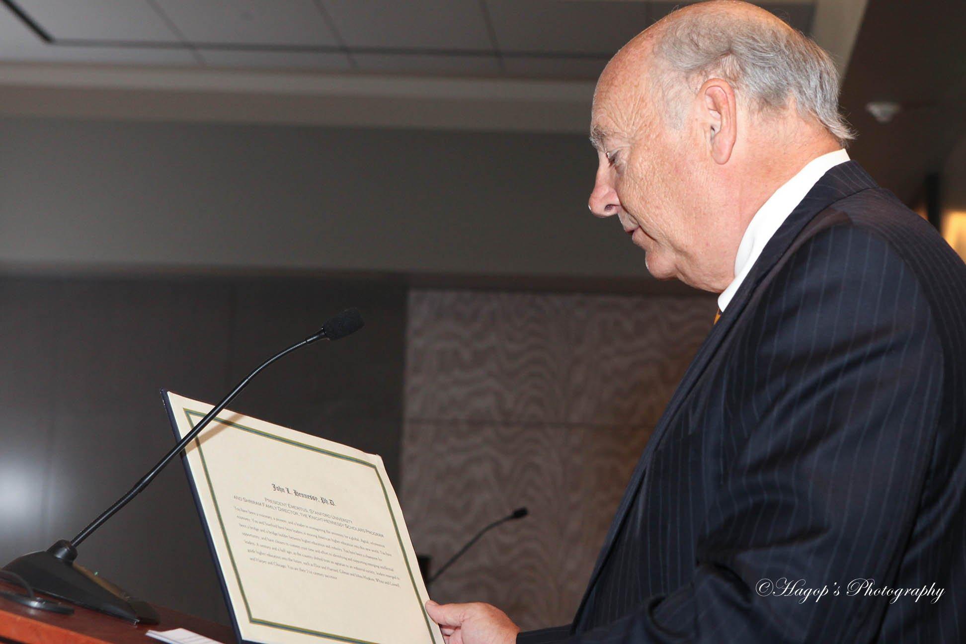 speaker reading the award