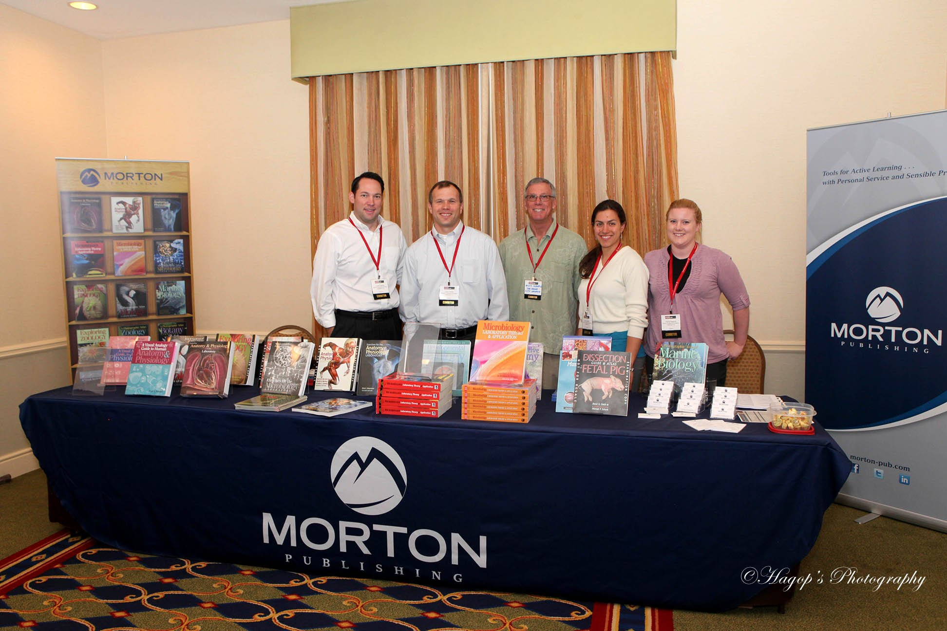 group photo posing at an exhibitor display during the conference