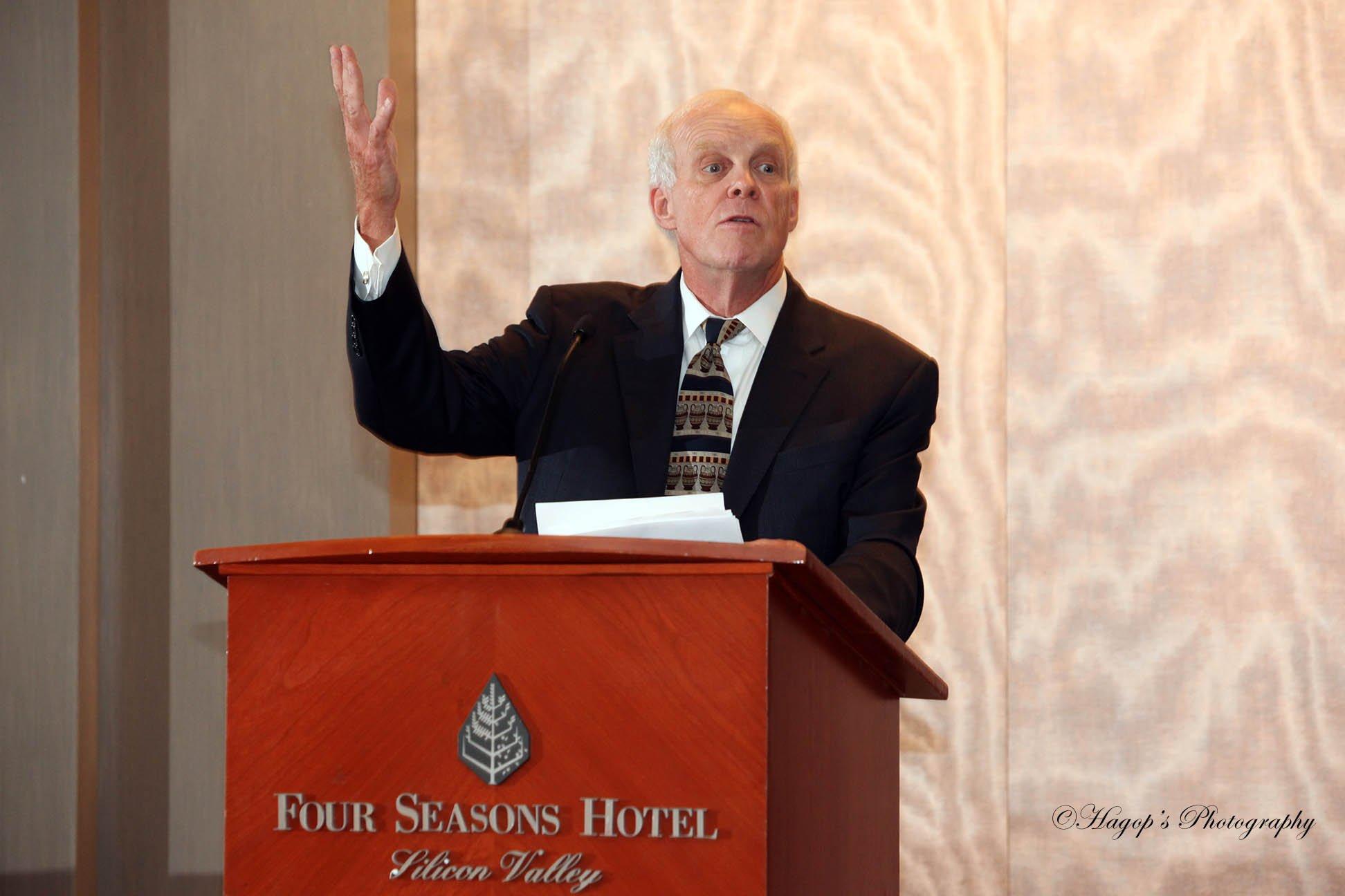 speaker raising hand