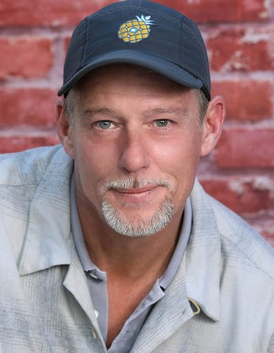 male wearing a hat photo with brick background