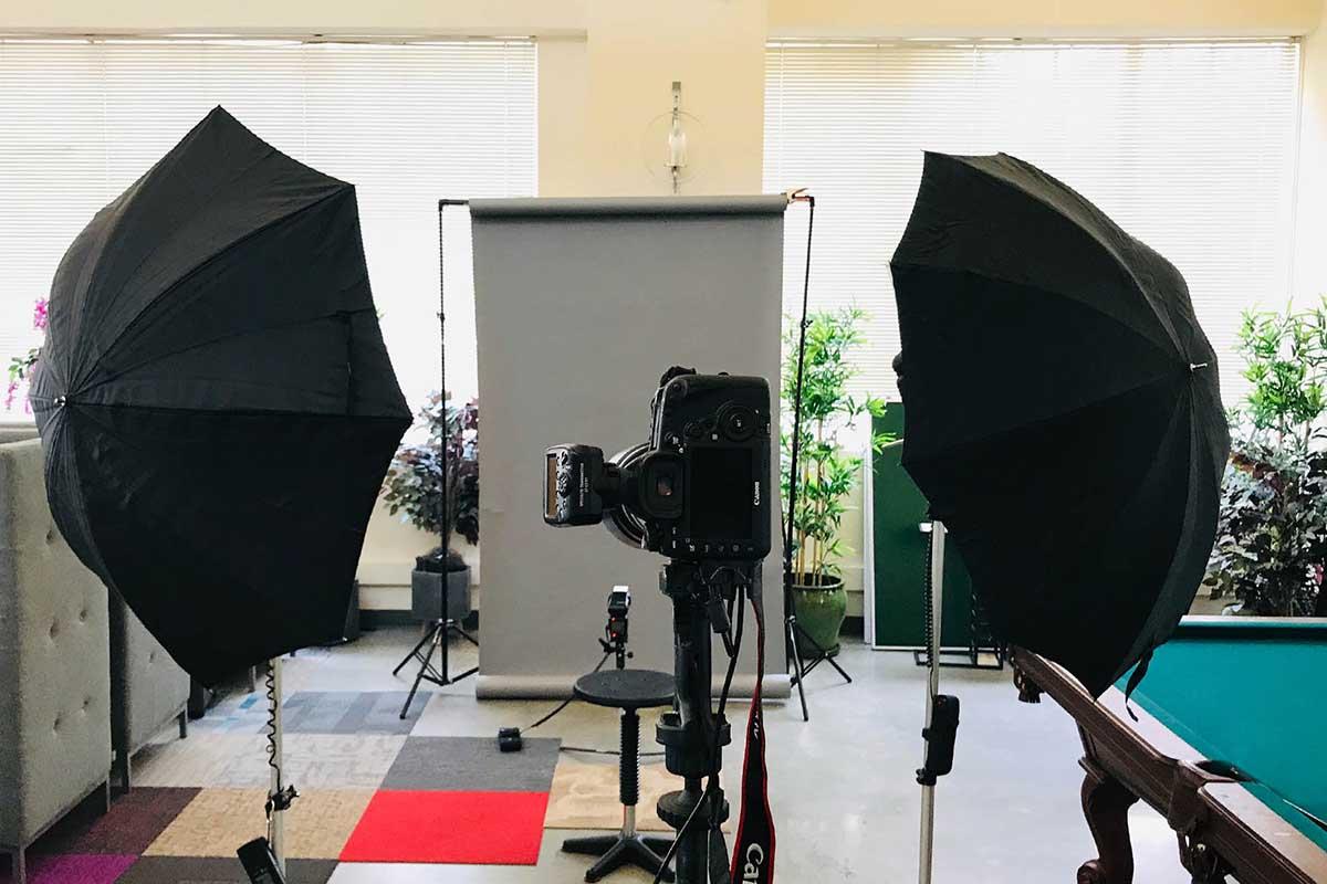 studio set up with umbrella lights and camera