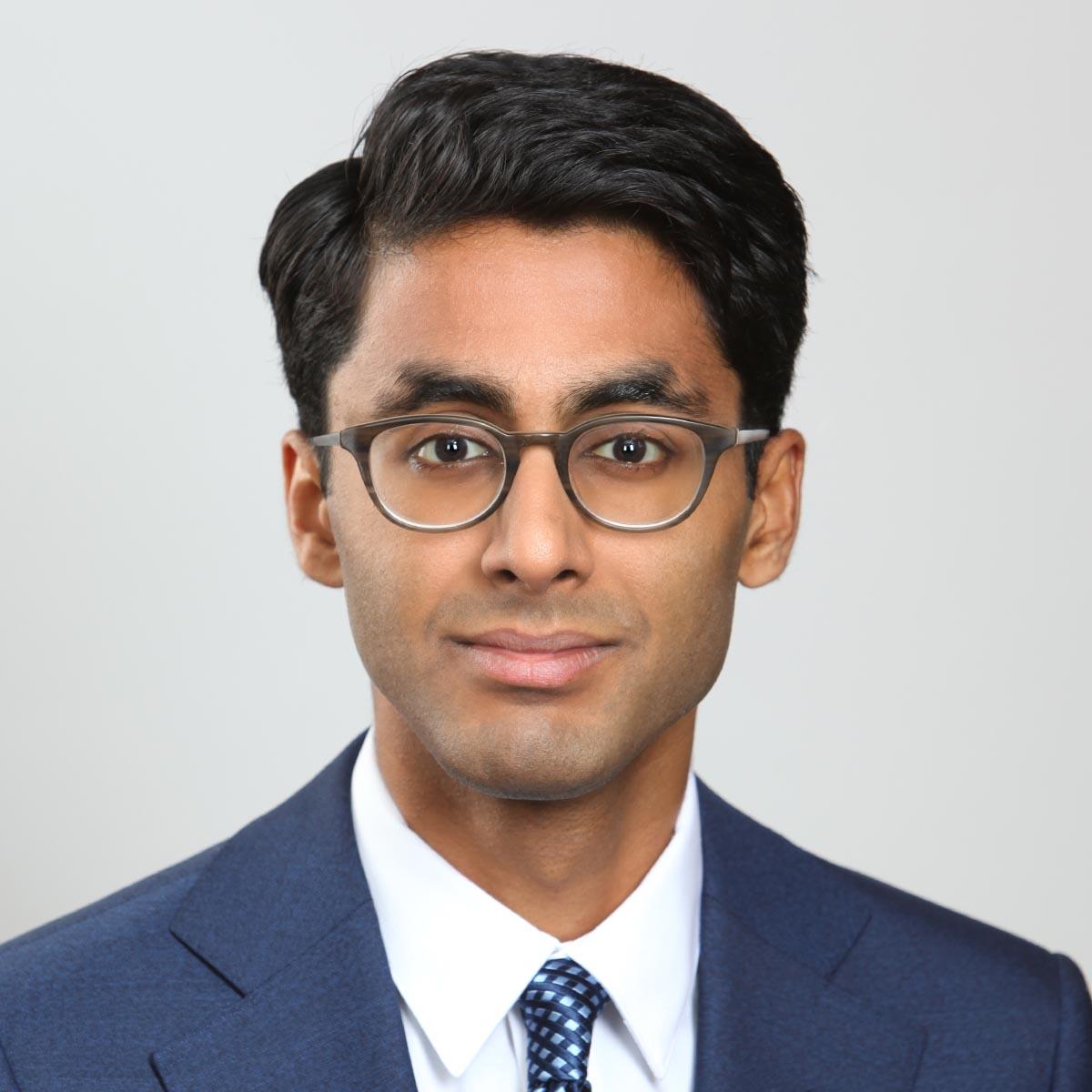 male headshot with eyeglasses