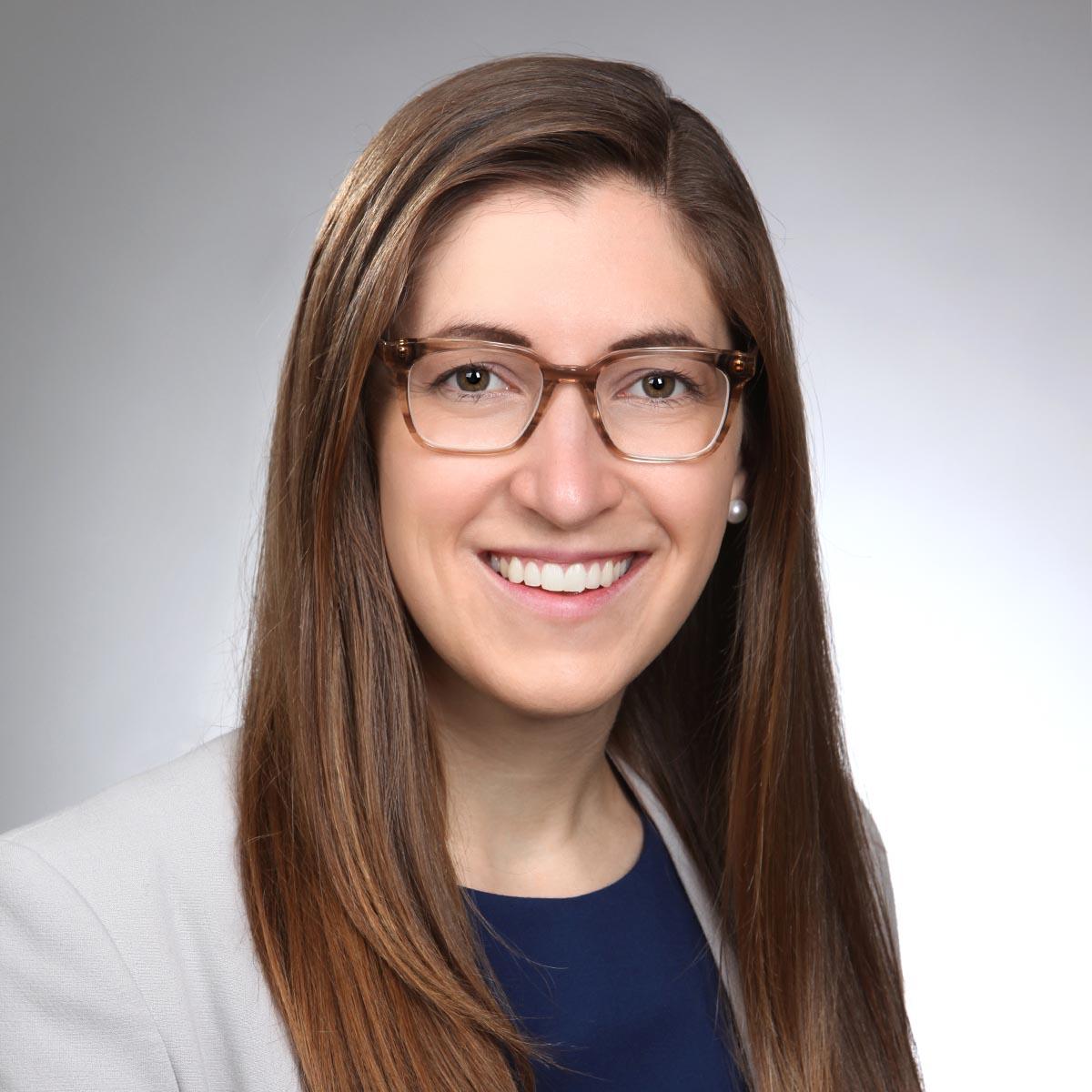 female headshot wearing eyeglasses
